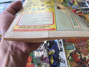 Assess condition of comic book to determine value